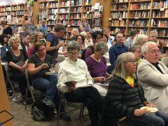 Attendees reading materials pre-program