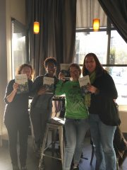 Four women holding up books. At March's meet-up, we celebrated milestones and received advance reading copies of Saeeda Hafiz's soon-to-be-released book.