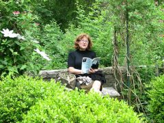 joan gelfand in the garden, poet and poets' coach